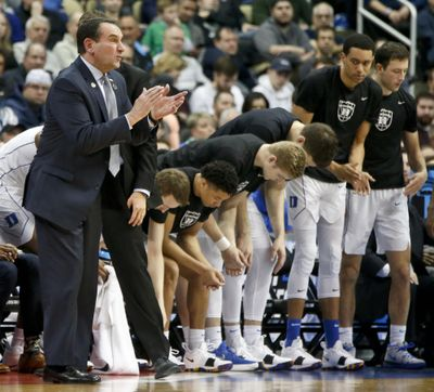 Duke head coach Mike Krzyzewski, left, claps beside his team as it plays Rhode Island in a second-round game in the men's NCAA Tournament on Saturday, March 17, 2018, in Pittsburgh. (Keith Srakocic / Associated Press)