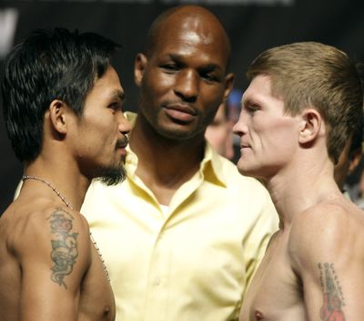 Associated Press Manny Pacquiao, left, and Ricky Hatton face off for a junior welterweight title tonight. (Associated Press / The Spokesman-Review)