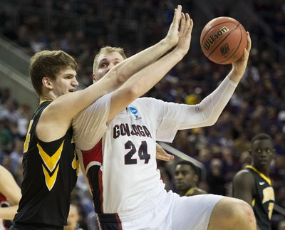 Gonzaga center Przemek Karnowski, right, will not participate in Senior Night, with one of his options being a return to the Bulldogs after his senior season was cut short after five games because of a back injury. (Colin Mulvany colinm@spokesman.com)