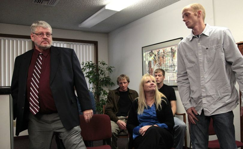 Ronald Reynolds, left, returns to his seat as his wife, Linda Reynolds, looks on and his son Jonathan Reynolds, right, steps up to speak during a news conference at an attorney's office Thursday, Nov. 10, 2011, in Olympia, Wash. Jonathan and Ronald Reynolds say they did not kill Ronda Reynolds in 1998, disputing the conclusion of an inquest jury. Ronald and Jonathan Reynolds said at the news conference that the accusations against them have been wrecking their lives. An inquest jury last month found the Reynolds men responsible for the death of Ronda Reynolds. The coroner issued arrest warrants for the two men, but the county prosecutor said there's not enough evidence to charge them criminally. (AP Photo/Elaine Thompson)   ( (AP Photo/Elaine Thompson))