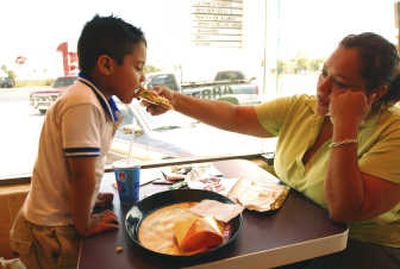 Anayancin Llanes, 35, and her son Maximiliano, 4, eat at the recently opened Taco Bell in Apodaca in northern Mexico last week. Associated Press  (Associated Press / The Spokesman-Review)