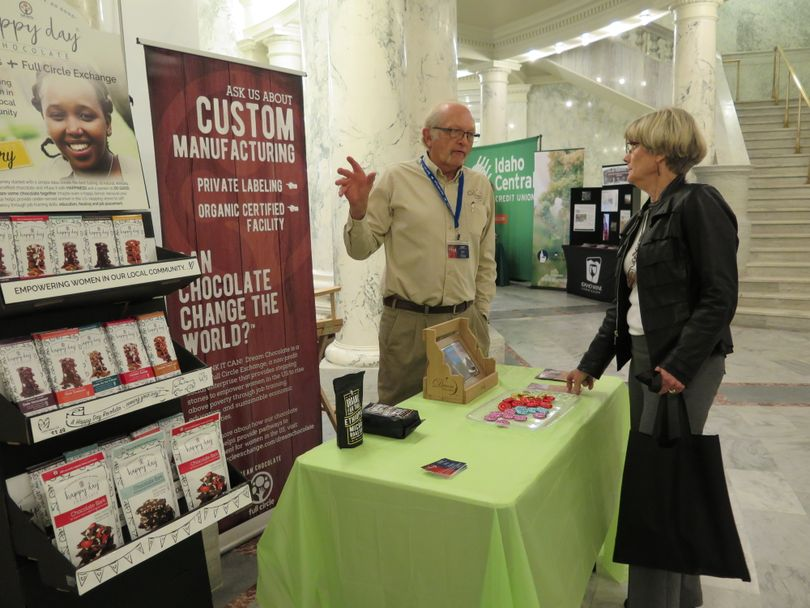 Sen. Janie Ward-Engelking, right, visits one of the dozens of booths set up in the Capitol rotunda for the annual Buy Idaho show on Wednesday, highlighting Idaho products and services. (Betsy Z. Russell)