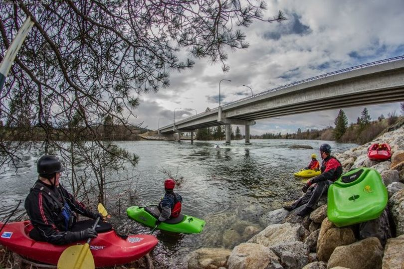 Kayakers stage to play in Dead Dog Hole on the Spokane River under the Stateline bridge. (Brian Jamieson)