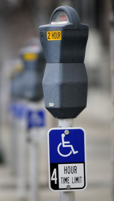 Disabled  parking signs have been added to some meters along Sprague and First avenues.  (Dan Pelle / The Spokesman-Review)