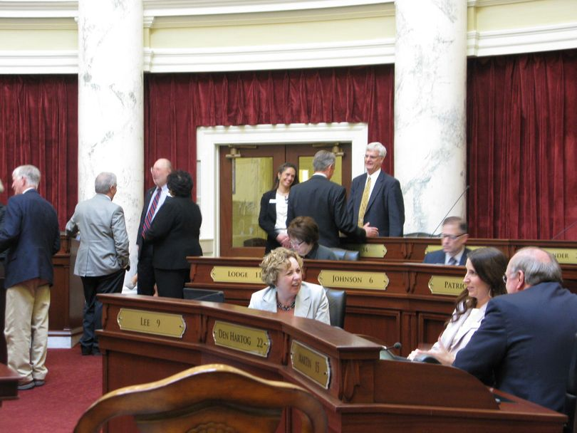 Senators mill around during a delay on Tuesday afternoon (Betsy Russell)