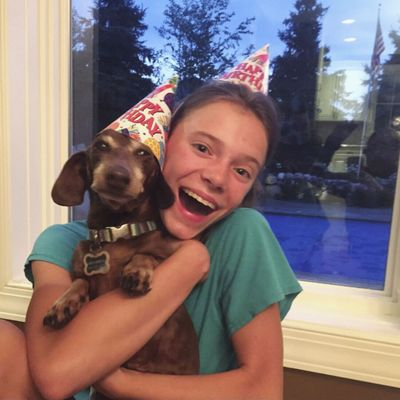 This August 2020 photo provided by Peyton Crest shows her with her dog at home in Minnetonka, Minn. The 18-year-old ays she developed anorexia before the pandemic but has relapsed twice since it began. ''It was my junior year, I was about to apply for college,'' Crest says. Suddenly deprived of friends and classmates, her support system, she'd spend all day alone in her room and became preoccupied with thoughts of food and anorexic behavior.  (HONS)