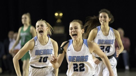 Central Valley players (from left) MJ Bruno, Grace Geldien and Chloe Williams celebrate the State 4A championship win over Woodinville on Saturday, March 7, 2020, in Tacoma, Wash. All three players return this season.  (Patrick Hagerty/For The Spokesman-Review)