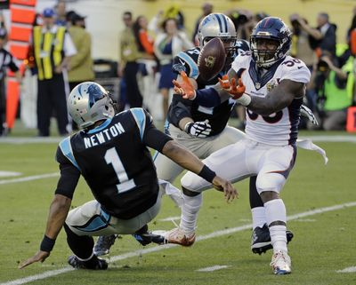 Denver Broncos Von Miller (58) strips the ball from Carolina Panthers Cam Newton (1) during the first half of the NFL Super Bowl 50 football game Sunday, Feb. 7, 2016, in Santa Clara, Calif. The Broncos recovered the fumble for a touchdown. (David J. Phillip / Associated Press)
