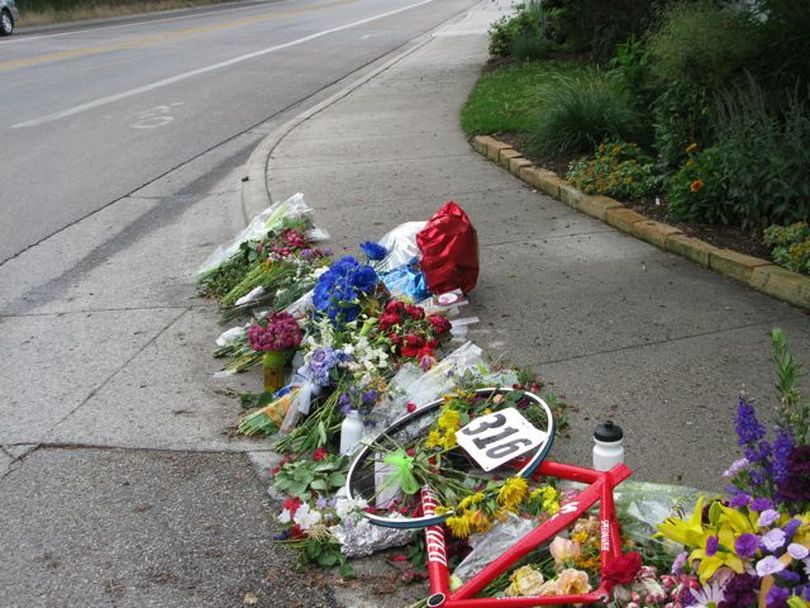 Flowers and mementos mark the spot where 37-year-old Kevin Pavlis of was struck and killed by a turning motorist while riding his bicycle along Hill Road in Boise, which has a bike lane. Pavlis was the third cyclist struck and killed on Boise-area roads in the past month. (Betsy Russell / The Spokesman-Review)