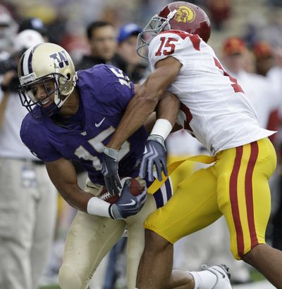 Associated Press Receiver Jermaine Kearse and the Huskies, left, shocked Kevin Thomas and the Trojans last Saturday. (Associated Press / The Spokesman-Review)