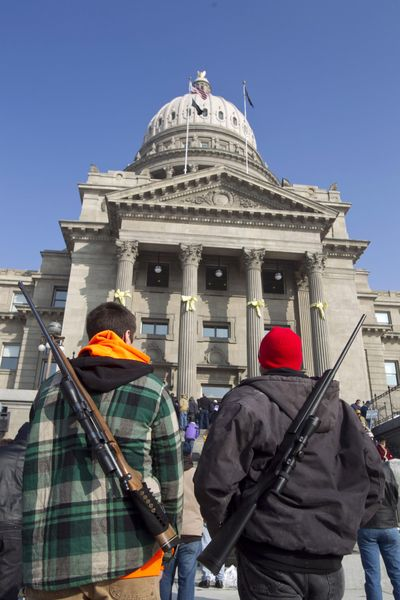 An estimated 800 pro-gun activists turned out for a rally inside the Idaho Statehouse in Boise, Idaho, Saturday, January 19, 2013. Chance Novak, 18, left, and his father, Chet Novak, both of Boise, stand outside the Idaho Statehouse after the rally. Exactly one year after it went into effect in 2016, an Idaho gun law that allows people to carry concealed firearms without a permit has had little effect on crime rates, state law enforcement officials said. (Chris Butler / Chris Butler/Idaho Statesman)