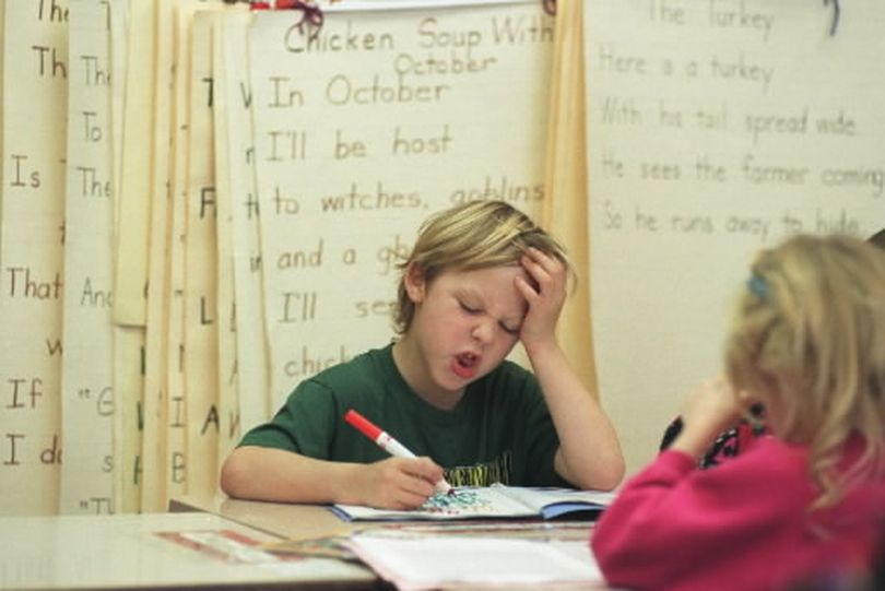 Garden Springs 1st grader Cody Gronau works on his pronouncation of the