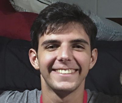 "This August 2019 photo provided by Dave Goren shows Max Goren smiling on move in day at North Carolina State University in Raleigh, N.C. A student from N.C. State University has kept alive a tradition associated with postseason college basketball. Max Goren produced his own version of ""One Shining Moment,"" similar to the video which CBS Sports showcases at the end of the men's national championship game. (Dave Goren / Associated Press)"