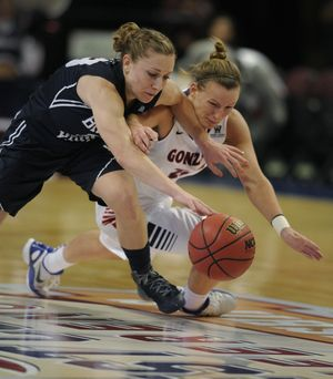 Gonzaga's Taelor Karr (12), right, and BYU' s Haley Steed (33) chase a loose ball in the first half of their WCC Tournament basketball game, Sat., March 9, 2013, in Las Vegas. (Colin Mulvany / The Spokesman-Review)