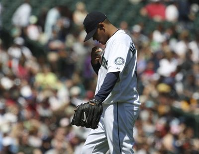 Mariners starter Felix Hernandez struck out a season-high 10 batters and earned his first victory since April 28. (Associated Press / The Spokesman-Review)