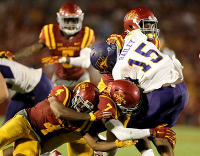 Northern Iowa quarterback Aaron Bailey is hit by Iowa State defenders during the second half of an NCAA college football game last Saturday in Ames, Iowa. Iowa State won 31-7. (Associated Press)