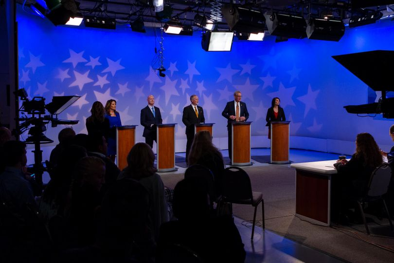 The five GOP candidates for lieutenant governor talk with debate moderator Melissa Davlin shortly before the start of their face-off in the