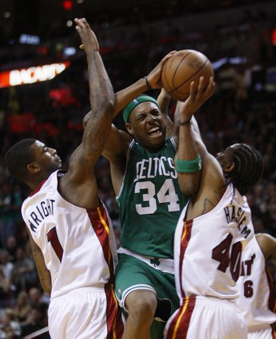 Celtics forward Paul Pierce goes up for a shot against Miami's Dorell Wright, left, and Udonis Haslem during the second half. (Associated Press)