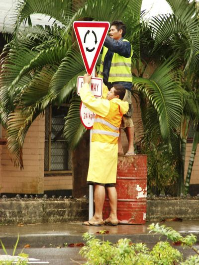 Land Transport Authority workers install traffic signs in Apia, Samoa, on Sunday, a day before the driving-side switch.  (Associated Press / The Spokesman-Review)