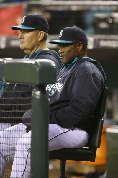 Manager Lloyd McClendon, right, and his Mariners posted 51-44 record entering the All-Star break. (Associated Press)