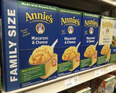 Boxes of Annie's Macaroni & Cheese are shown on the shelf at a supermarket in Edina, Minn., Sunday, March 4, 2018. Annie's is an organic and natural unit of food industry giant General Mills. (Associated Press)