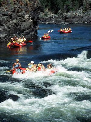 A group of Riverview Retirement Community senior citizens ranging from 70 to 90 years old head into their final dose of whitewater during a rafting trip down the Clark Fork River.   (The Spokesman-Review)