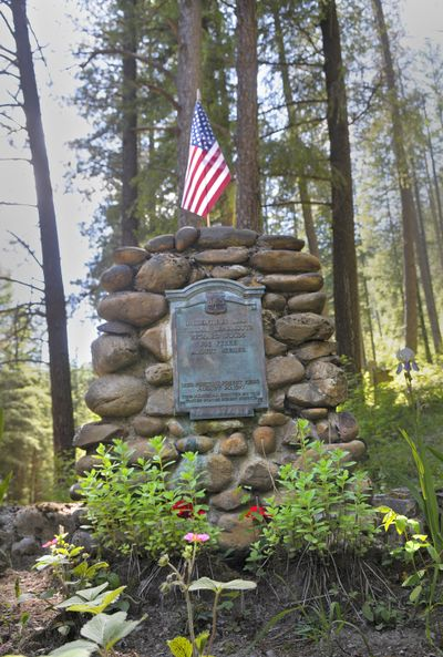 A mass grave in the Wallace Idaho Ninemile cemetary marks the final resting place of five men killed in the 1910 fire. (Christopher Anderson / The Spokesman-Review)