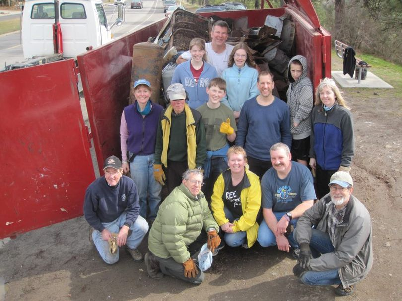 Volunteers pose with the metal-recyclable garbage they cleared  from the South Hill Bluff below High Drive on March 24, 2012. (Friends of the Bluff)