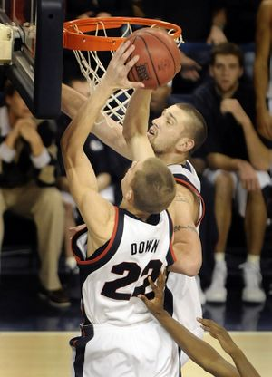 Micah Downs, left, and Josh Heytvelt of Gonzaga crash the offensive boards against San Francisco  during their game Saturday, Jan. 17, 2009, in Spokane. Downs controlled this rebound and got the putback for a score. (Christopher Anderson / The Spokesman-Review)