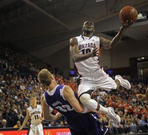 Guy Landry Edi of Gonzaga flies over the defense of Ryan Nicholas of Portland on Dec. 28, 2011. (Christopher Anderson)