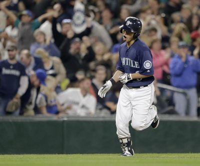 Seattle's Nori Aoki rounds the bases after hitting a solo home run off Oakland's Raul Alcantara during the third inning Friday. (John Froschauer / Associated Press)