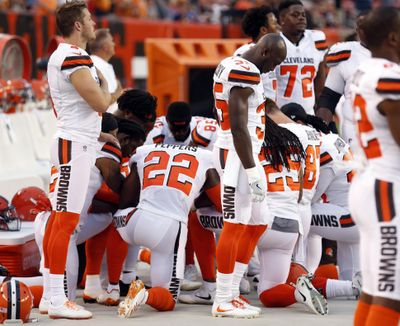 FILE - This Aug. 21, 2017, file photo shows members of the Cleveland Browns kneeling during the national anthem before an NFL preseason football game against the New York Giants, in Cleveland. (Ron Schwane / Associated Press)