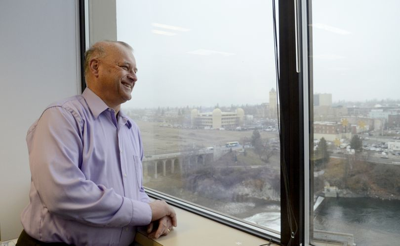 Joe Shogan, Spokane City Council president, looks out at the Spokane River view from his seventh floor office. Shogan was busy packing up his belongings and saying goodbye to city staff Thursday. Ben Stuckart is taking his place. (Jesse Tinsley)