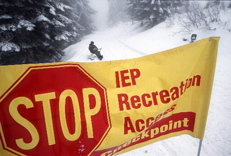 In 2004, Inland Empire Paper Company attempted to charge a fee for snowmobile access to their lands on Mount Spokane and educate riders about the need to stay on designated trails.  The program has failed to keep the riders from going off trail into clearcuts where they damage the tops of young trees. This winter, IEP is closing its lands to snowmobiling. A barricade fence will be set up at this access point to Linder Road near the cross-country ski trails. (Rich Landers)