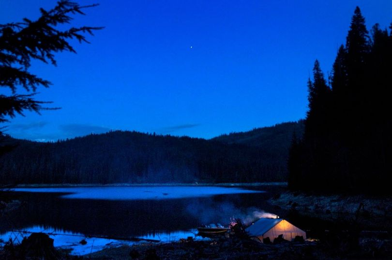 Night falls on a spring boat-in tent camp at a primitive site on Dworshak Reservoir. (Jed Conklin)