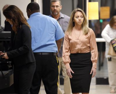 Fired Dallas police Officer Amber Guyger, right, arrives for jury selection in  a murder trial at the Frank Crowley Courthouse in downtown Dallas, Friday, Sept. 13, 2019. Guyger shot and killed Botham Jean, an unarmed man in his own apartment last year. (Tom Fox / Associated Press)
