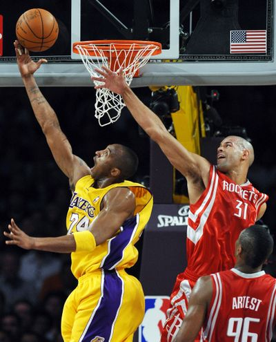 L.A.'s Kobe Bryant goes to the basket against Houston's Shane Battier.  (Associated Press / The Spokesman-Review)