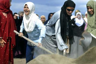 Members of the Spokane Islamic Center break ground for their new mosque on Friday on East First Avenue.  (Photos by Jed Conklin / The Spokesman-Review)