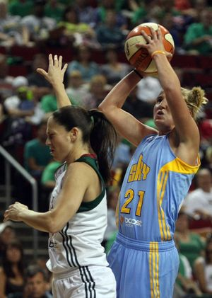 Former Gonzaga standout Courtney Vandersloot attempts a shot over Seattle's Sue Bird during the Storm's 81-70 win over Chicago. (Associated Press)