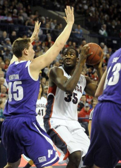 Gonzaga's Sam Dower (35) will square off against Kramer Knutson, left, and Portland on Thursday. (Jesse Tinsley)