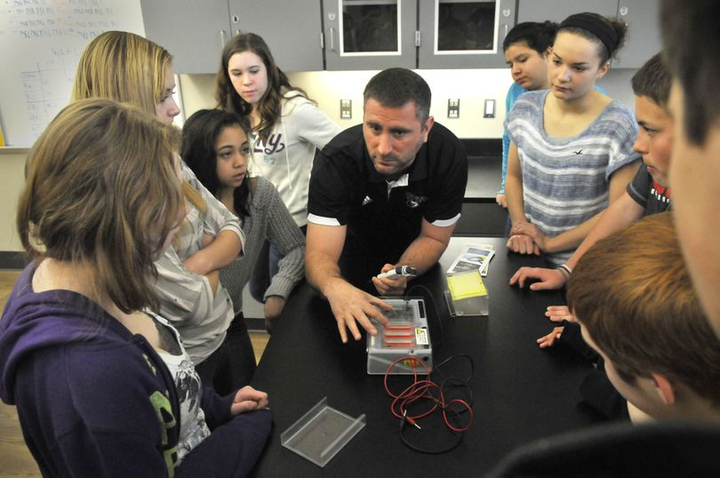Central Valley High School biology teacher Phil Plesek, center, talks about DNA with a group of Evergreen Middle School eighth-graders Wednesday at Spokane Valley Tech. Eighth-graders from Spokane Valley schools have been taking tours of the tech education center where career and science-oriented classes are available. (Jesse Tinsley)