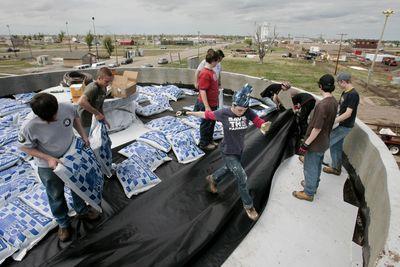 High school students from Avonmore, Ontario, prepare a Greensburg, Kan., home's roof garden. Kansas City Star (Jill Toyoshiba Kansas City Star / The Spokesman-Review)