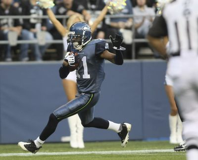 Seattle Seahawks' Deon Butler scores a touchdown in the first quarter.  (Associated Press / The Spokesman-Review)