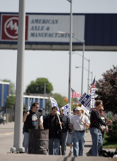 American Axle & Manufacturing and Local 235 employees walk the picket line outside American Axle & Manufacturing on Friday, May 9, 2008, in Detroit. (Jerry S. Mendoza / associated press)