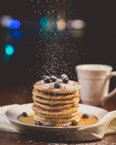 For a bit more sweetness and pretty presentation, use a sieve to sprinkle powdered sugar over the pancakes.  (Pixabay)