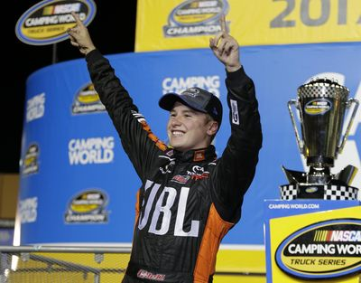 Christopher Bell celebrates in Victory Lane after winning the NASCAR Truck Series auto racing season championship at Homestead-Miami Speedway in Homestead, Fla., Friday, Nov. 17, 2017. (Terry Renna / Associated Press)
