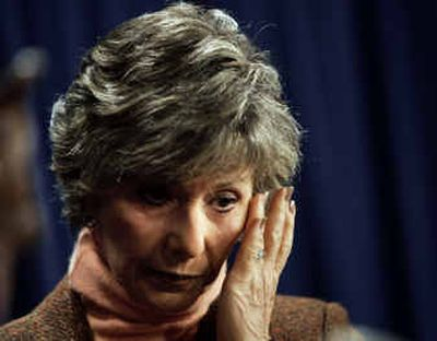 Sen. Barbara Boxer, D-Calif., wipes away a tear as she announces with Rep. Stephanie Tubbs Jones, D-Ohio, that they will object to the certification of Ohio's electoral votes.   (Associated Press / The Spokesman-Review)