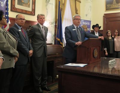 Sen. Todd Lakey, R-Nampa, speaks out in favor of a crime victim rights constitutional amendment on Thursday, joined by state officials, prosecutors, law enforcement representatives and crime victims. At left are Sen. Cherie Buckner-Webb, Sen. Chuck Winder, and Gov. Butch Otter; at right in the black hat is Canyon County Sheriff Kieran Donahue. (Betsy Z. Russell)