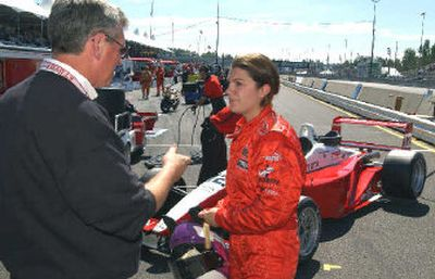 Katherine Legge is congratulated on placing fourth in Toyota Atlantic race by team owner Jim Griffith at Portland.   (Associated Press / The Spokesman-Review)