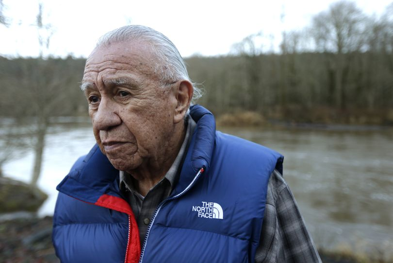 In this January photo, Billy Frank Jr. poses for a photo near Frank's Landing on the Nisqually River in Nisqually, Wash. Frank died Monday. (Associated Press)